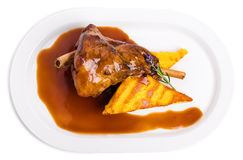 Fried lamb shank with polenta. Royalty Free Stock Photography