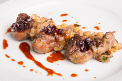 Fried lamb tongues with garnish. And berries Royalty Free Stock Image