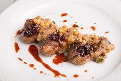 Fried lamb tongues with garnish. And berries Royalty Free Stock Photography