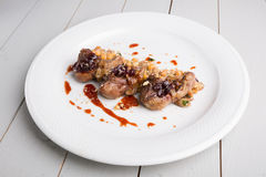 Fried lamb tongues with garnish. And berries Stock Images