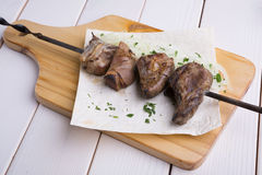 Fried lamb tongues. On a metal skewer Royalty Free Stock Photos