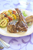 Fried lamb with vegetable garnish Stock Photo