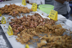 Fried little squid at thai market style with a yellow card of name of this food and price , selective focus, filtered image Stock Photography