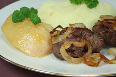 Fried liver. With mashed potatoes and glazed pear stock image