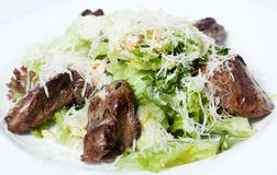 Fried liver with green salad Stock Photography