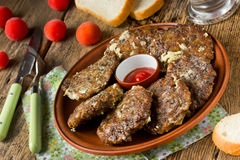 Fried liver pancakes in a rustic style Stock Photo