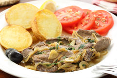 Fried liver pork - Portuguese traditional food Stock Photography