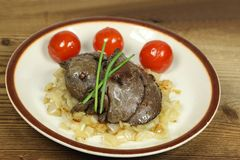 Fried livers on onion royalty free stock photos