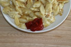 Fried macaroni with cheese and ketchup royalty free stock images