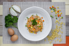 Fried macaroni with egg and pork and vegetable in tomato sauce i Royalty Free Stock Images