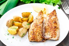 Fried mackerel with baked potato royalty free stock photos