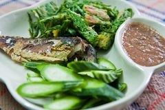 Fried Mackerel fish,chili sauce ,and fried vegetab Royalty Free Stock Photography