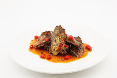 Fried Mackerel fish in chili sauce Stock Photos