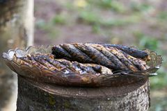 Fried mackerel on the grill Royalty Free Stock Photo