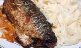 Fried mackerel and macaroni Stock Photos