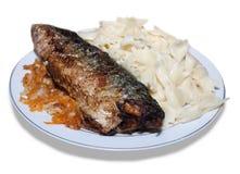 Fried mackerel and macaroni. Isolated Royalty Free Stock Images