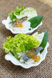 Fried mackerel served with boiled thai rice vermicelli. Stock Photography