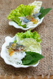 Fried mackerel served with boiled thai rice vermicelli. Stock Image