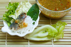 Fried mackerel served with boiled thai rice vermicelli. Royalty Free Stock Photo