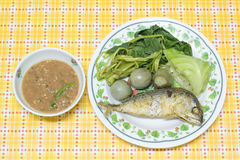 Fried mackerel with shrimp paste sauce on yellow pattern table Royalty Free Stock Image