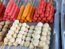 Fried meat balls, meat ball rugby and cocktail sausages in bamboo skewers. Meat ball stick.fried meat balls, meat ball rugby and cocktail sausages in bamboo stock image