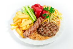 Fried  meat balls with french fries and salad Royalty Free Stock Photos
