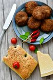 Home made   meat balls. Fried meat balls ,  hand made ciabatta bread with olive oil and spices , parmesan cheese and cherry tomatoes Stock Photography