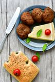 Home made   meat balls. Fried meat balls ,  hand made ciabatta bread with olive oil and spices , parmesan cheese and cherry tomatoes Stock Image