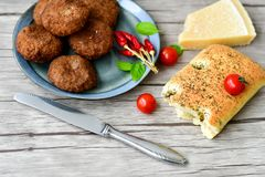 Home made   meat balls. Fried meat balls ,  hand made ciabatta bread with olive oil and spices , parmesan cheese and cherry tomatoes Royalty Free Stock Photo