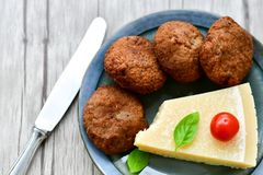 Home made   meat balls. Fried meat balls ,  hand made ciabatta bread with olive oil and spices , parmesan cheese and cherry tomatoes Stock Photo