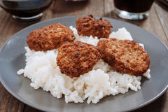 Fried meat balls over rice in gray earthenware Royalty Free Stock Photo