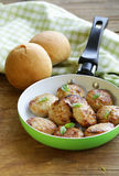 Fried meat burgers  in a frying pan Stock Photo