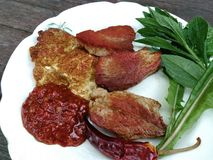 Fried meat and egg. With Abkhazian Adzhika stock photo