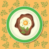 Fried meat with egg and parsley on the plate. Orange background with pattern Royalty Free Stock Photos