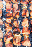 Fried meat on fire. Fast street food Royalty Free Stock Images