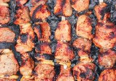 Fried meat on fire. Fast street food Stock Photo