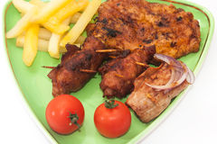 Fried meat with french fries and cherry potato on the plate Royalty Free Stock Image