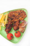 Fried meat with french fries and cherry potato on the plate Stock Images