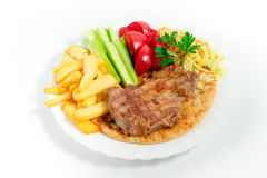 Fried  meat  with french fries and salad Royalty Free Stock Photography