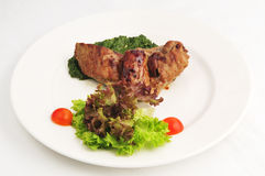 The fried meat with a garnish Royalty Free Stock Photography