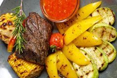 Grilled meat with garnish of vegetables royalty free stock photography