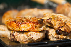 Fried meat on a grill. Beef steak fried on a grill Royalty Free Stock Photos
