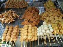 Fried meat at a market . Fast food at market Royalty Free Stock Photos