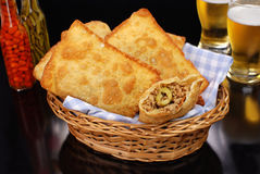 Fried meat Pastel in a basket in black background with one open Royalty Free Stock Photos