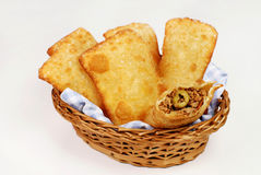 Fried meat Pastel in basket in white background with one open Stock Photo