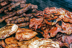 Fried meat placed on the grill Stock Images