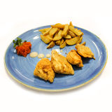 Fried meat and potato on big plate. Royalty Free Stock Photography