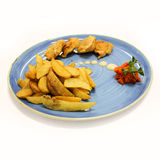 Fried meat and potato on big plate. Stock Image