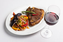 Fried meat and red wine royalty free stock photography