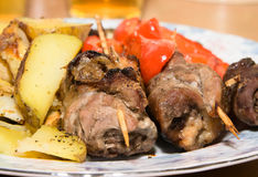 Fried meat rolls with vegetables. Rolls of meat with vegetables and baked potatoes Royalty Free Stock Image